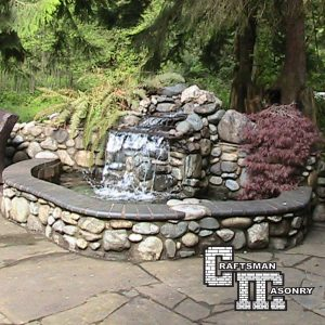 High end patio and outdoor kitchen by Craftsman Masonry INC